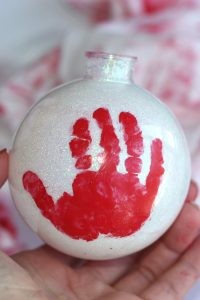 How to make baby's first Christmas memorable - with ornaments, photos, outfits, and crafts