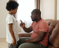 Dad talking to child sternly