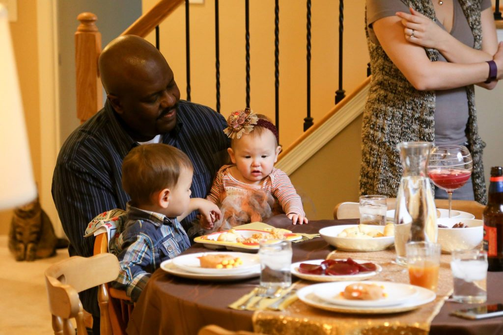 Eating dinner for Baby's first Thanksgiving