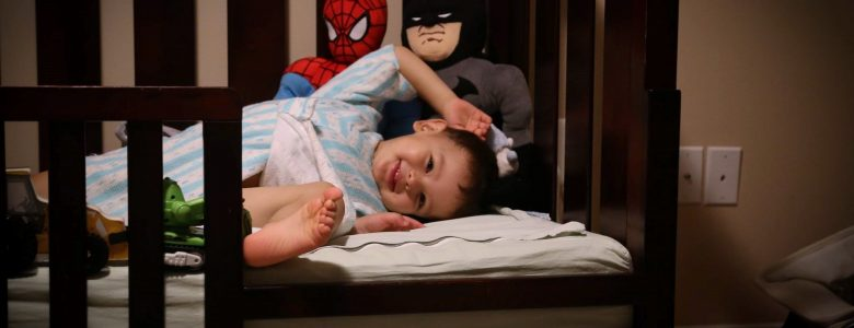 Toddler after converting to new crib