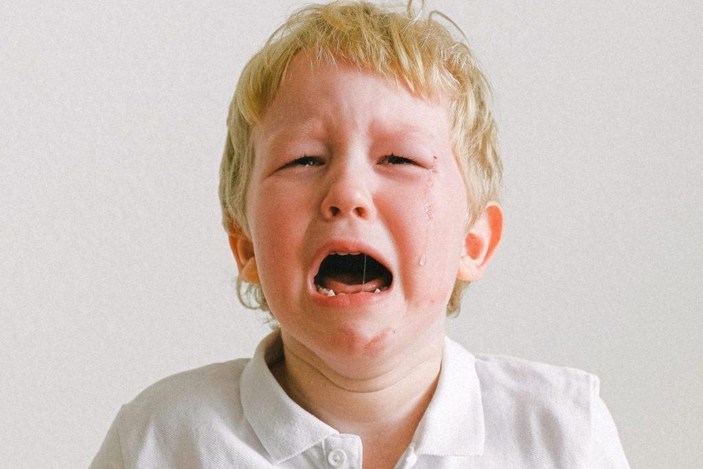3 year old blonde boy having a tantrum
