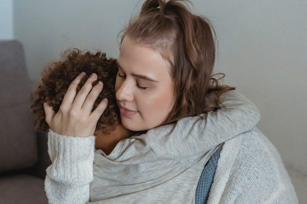 Mother comforting child during tantrum