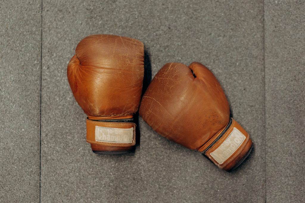 2 boxing gloves, we all want to know how to stop siblings fighting
