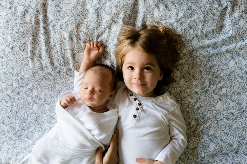Toddler with baby sibling